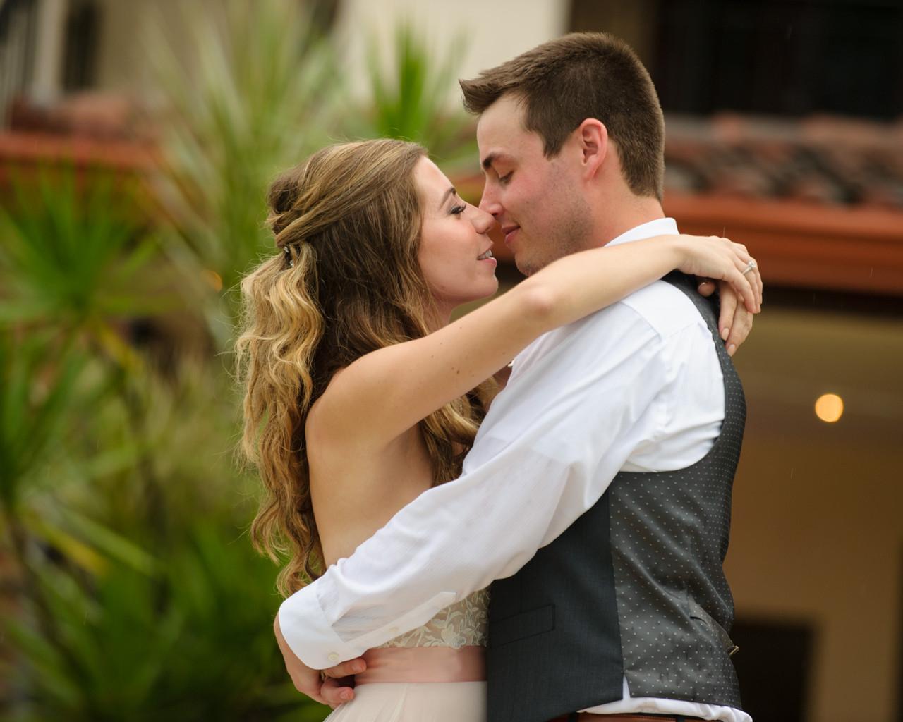 Bride and groom lost in a kiss at Villa Tranquila in Hacienda Pinilla