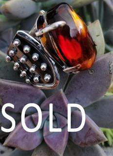 SOLD--Red amber ring set in silver $1,200 pesos plus shipping (mas envio)