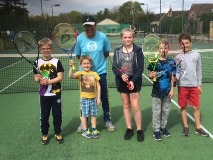Juniors enjoying fun tennis with coach James Hilltout at Bourton Vale LTS's Open Day on Saturday 13 May