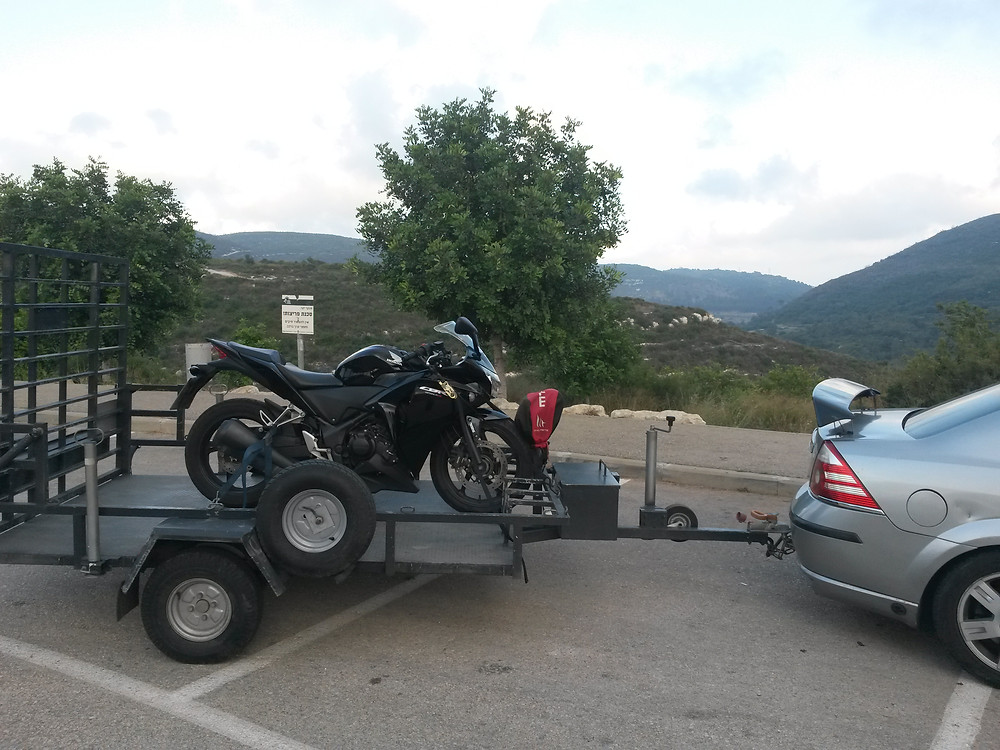 Honda CBR250R on the tow truck back to the shop