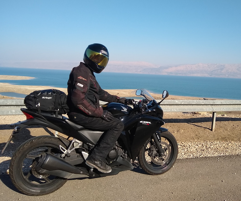 On my Honda CB250R off of road 90 with the Dead Sea in the background