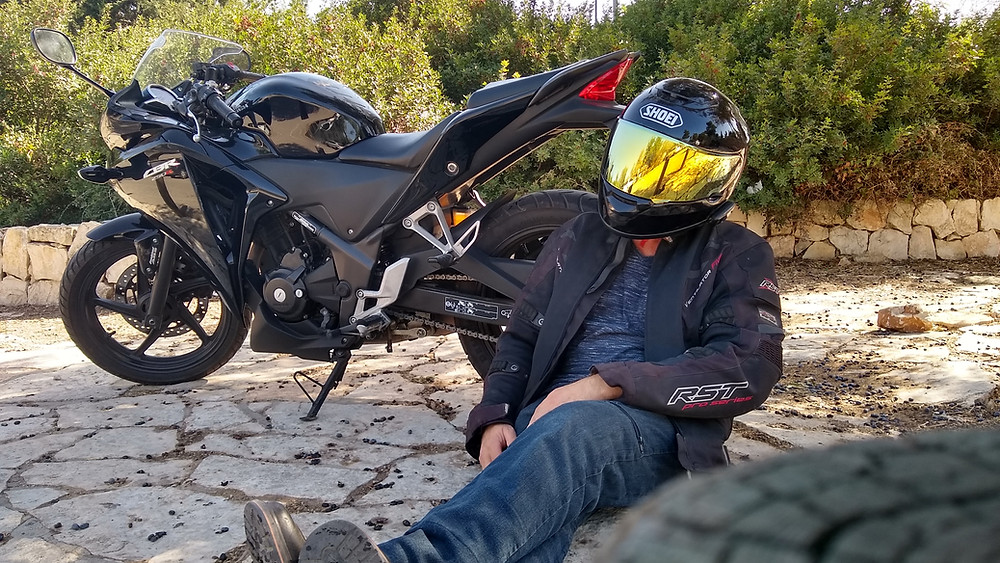 The author on his Honda CBR250R thinking about the cost of owning his Honda CBR250R.
