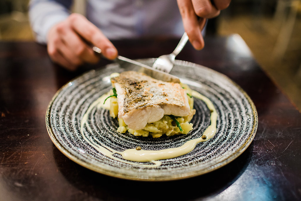 pan seared hake, crushed new potatoes, samphire + caper beurre blanc