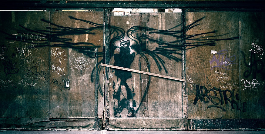 Photograph of Cuban street art depicting Fidel Castro a an angel of death.