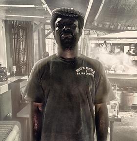 Portrait of chef in kitchen.