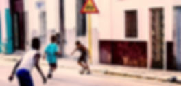 Photograph of kids playing soccer in the streets of Havana, Cuba.