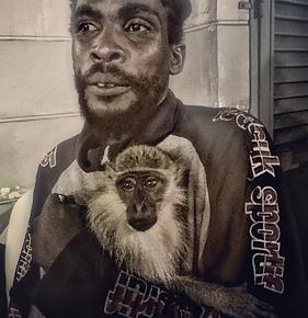Portrait of man holding monkey.
