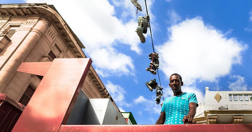 Portrait of man standing in truck bed in Havana, Cuba.