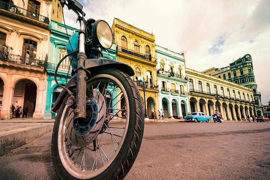 Photograph of soviet motorbike parked on the street in Havana, Cuba.