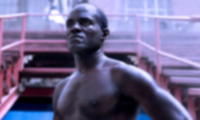 Olympic Cuban boxers sparring in boxing ring.