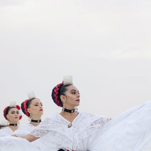 Photograph of a Mexican women dancing Mexican ballet.