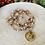 Thumbnail: Sautoir tout en perles de cristal Beige/Doré avec pendentif Ange Gardien