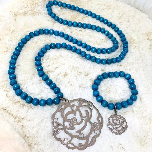 Sautoir et Bracelet en Bois Bleu clair avec Pendentif Sérénités