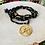 Thumbnail: Sautoir tout en cristal noir et doré avec pendentif OM