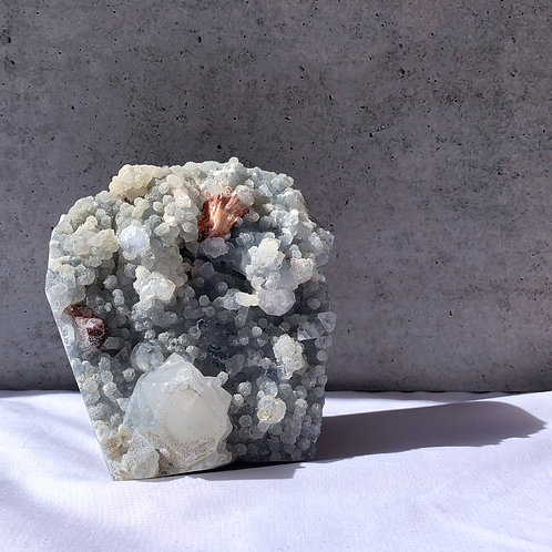 Zeolite - Apophyllite on Blue Chalcedony with a Ruby Stilbite inclusion