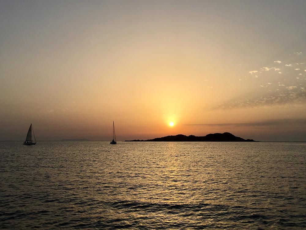 Sunrise behind Isola Rossa, Sardinia