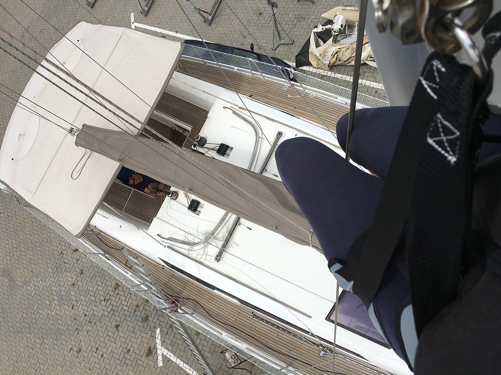 Co-captain hoisted up the mast