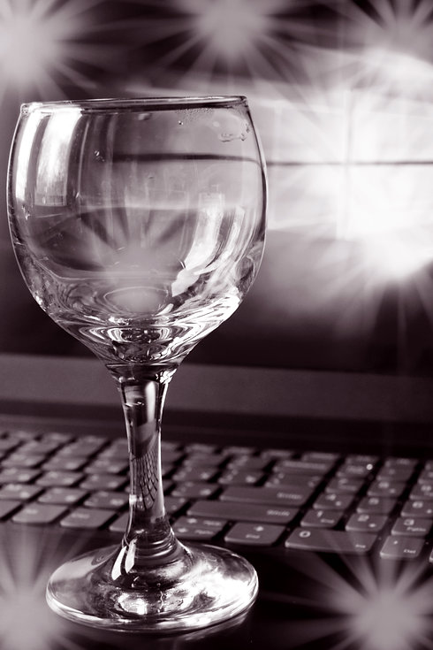 wine glass and laptop.jpg