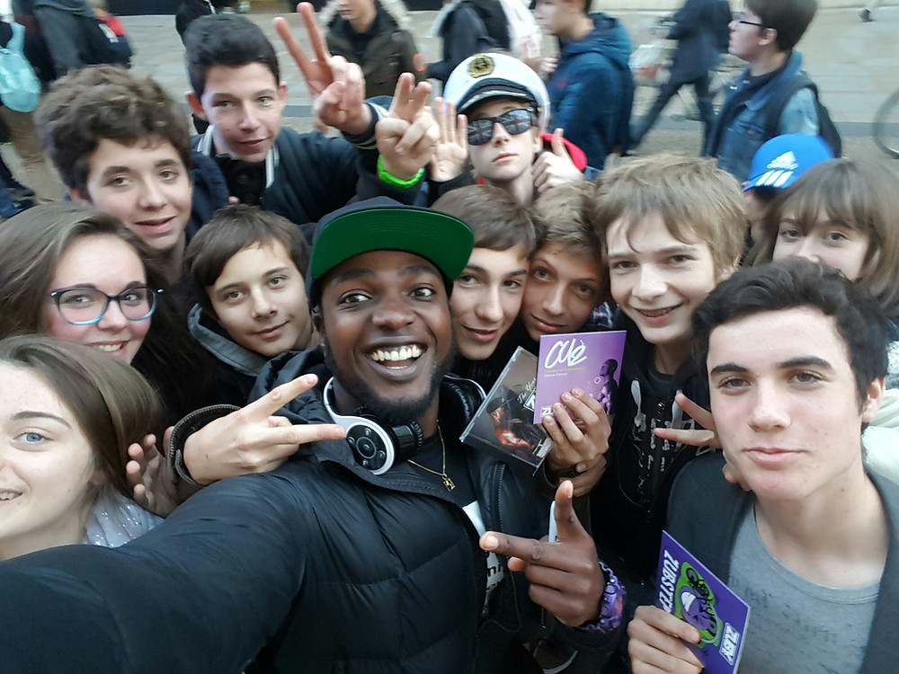 Zuby with group of young fans