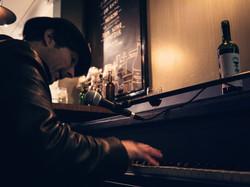 Blue Jo's Chris Piano & bottle