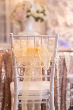 White Chiavari chair with gold bow