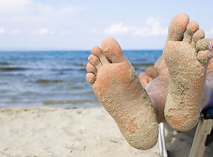 bigstock-man-s-feet-with-sand-on-a-summ-