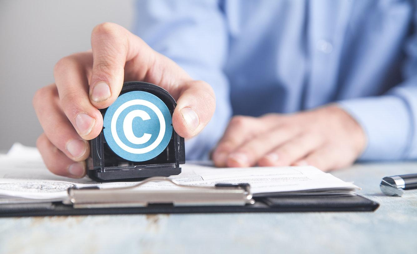 man-showing-copyright-symbol-copyright-i