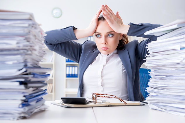 Overhelmed busniesswoman holds her head as she looks at mounds of paperwork. This could represent the stress from trying to deal with private practice paperwork. Contact Private Practice Startup to learn of our free HIPAA forms in Fort Lauderdale, FL to support your practice.