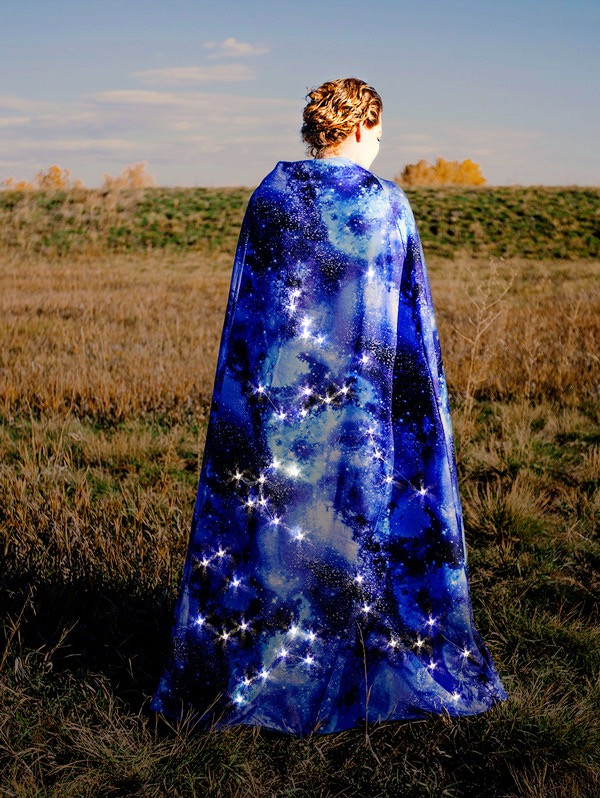 Woman in a field with a Night Sky Magical Cloak