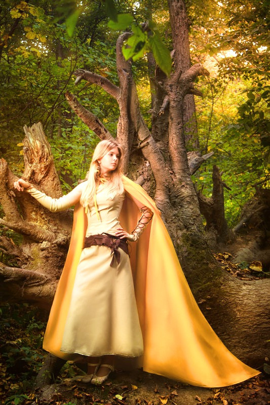 Blonde Woman in a Golden Energy Cloak