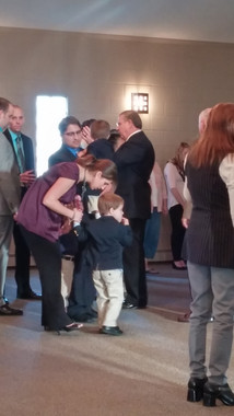 Dr. Barclay praying for the congregation