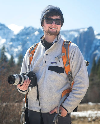 Chase Dekker stands in Yosemite Valley. Chase Dekker is a wildlife and conservationist photographer.