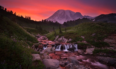 Edith Creek is photographed underneath Mt. Rainier at sunset on Chase Dekker's private tour.