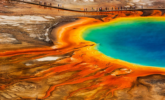 The Grand Prismatic Spring's explosive colors are photographed on Chase Dekker's Grand Teton workshop.