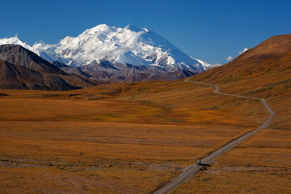 A lone road bisects Denali National Park. Photographed by Chase Dekker.