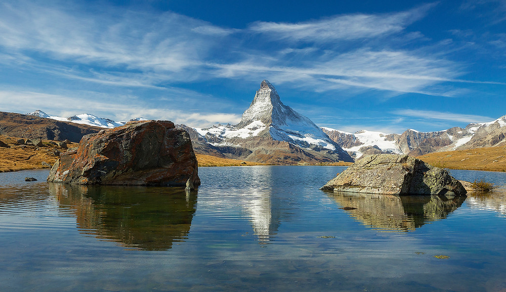 The Matterhorn stands tall above Stellisee Lake on a clear, beautiful in Zermatt, Switzerland. Photographed by Chase Dekker.