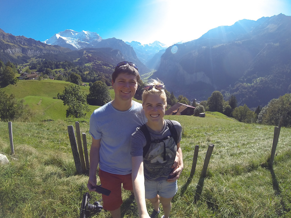 Chase Dekker and Hanna Glafke pose for a photo on a spectacular day in Wengen, Switzerland.
