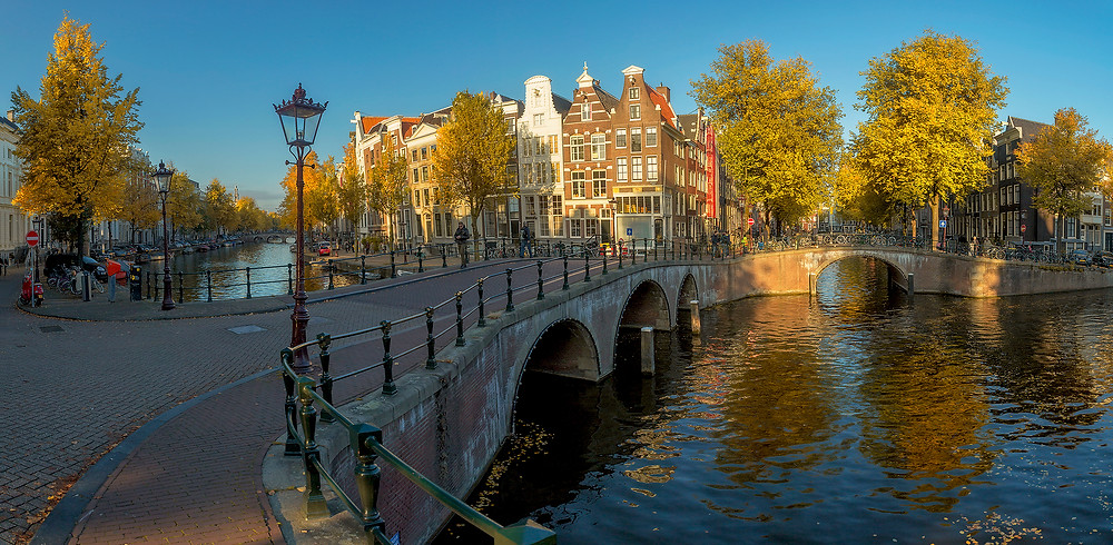 The canals of Amsterdam spread out below the city on a fine fall day. Photographed by Chase Dekker.