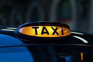 Closeup to a London Taxi Sign.jpg