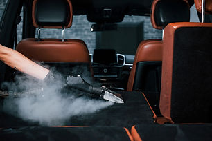Uses steam cleaner. Modern black automob