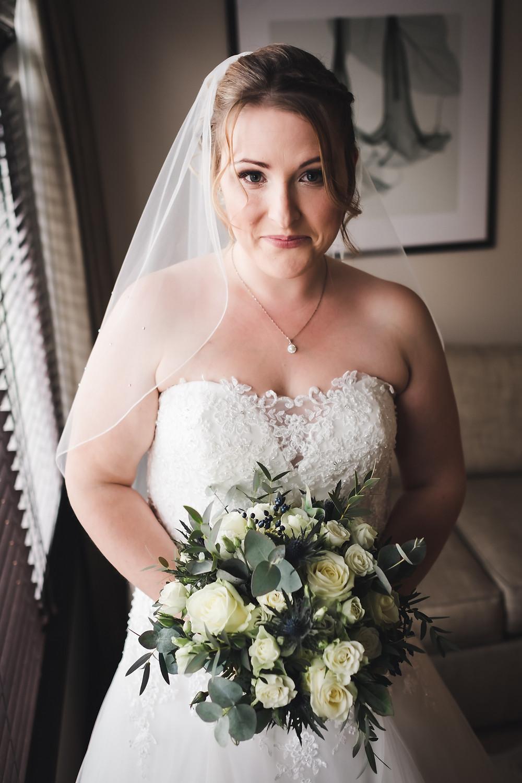 Window light bride portrait. Flowers by Fig flowers