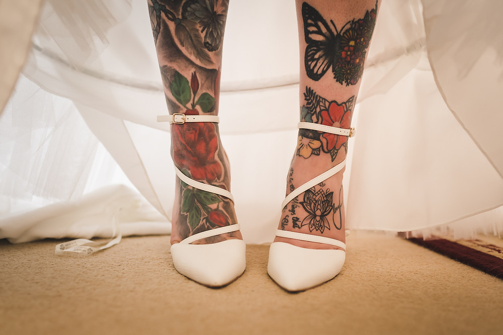 Tattoos and wedding shoes