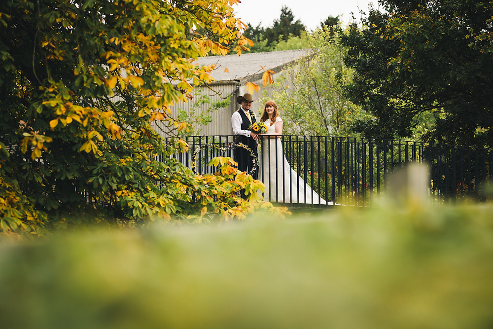 Autumnal Newlywed portrait at Bassmead Manor Barns
