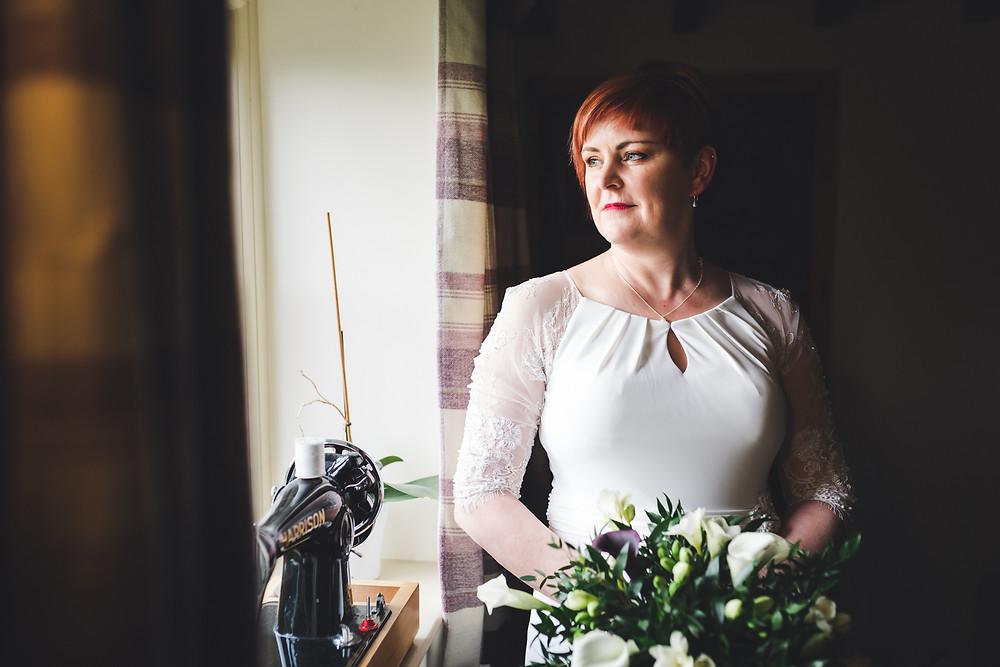 Bridal portrait by window