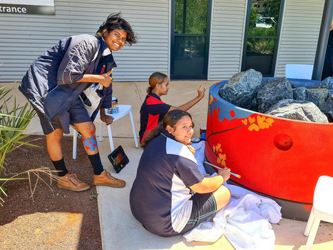 Students from the STARS Program painting the EPIC Karratha soakwells