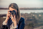 Portrait-of-photographer-covering-her-fa