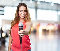 young-woman-offering-microphone-on-white