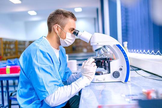 male-scientist-chemist-working-with-micr