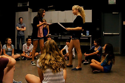 2 campers perform a scene in class