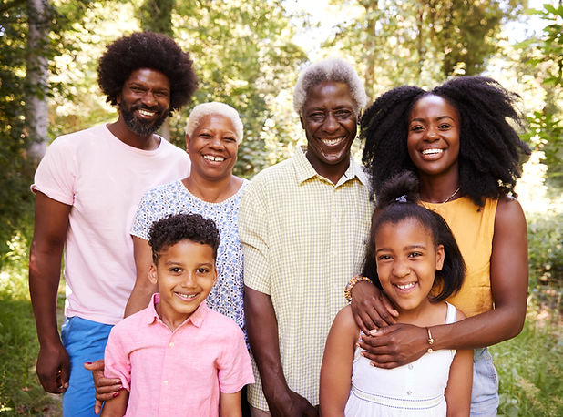 multi-generation-black-family-in-a-fores